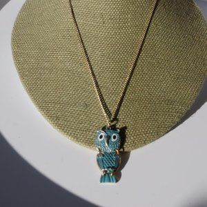 Women`s gold tone blue owl necklace. 17 inches lon